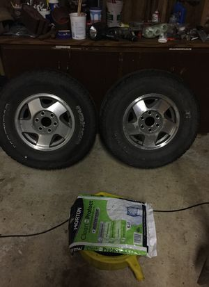 GMC/ Chevy 16 inch wheels and tires ) 4 total okay condition, two different brand of tire's ) no holes but seem to slowly leak air. $15 ea obo for Sale in Eatonville, WA