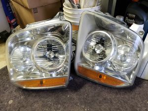 2007 GMC Yukon Headlights for Sale in Grand Rapids, MI