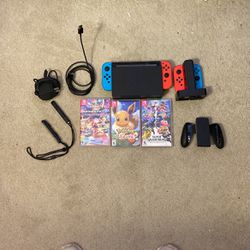 nintendo switch/ 3 games/ controller charging deck, 2 extra blue and red controllers, for Sale in Gilbert,  AZ
