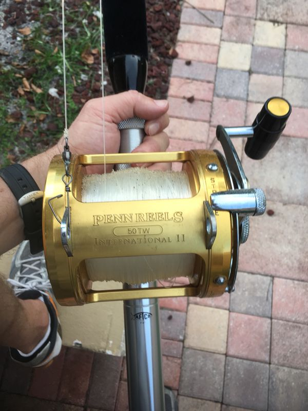 4 Penn International II 50TW reels with 50lb Tycoon HRH Big Game FinNor  rods, 1 Heavy Duty FinNor Trolling Rod and Reel, and 1 rod for extra parts