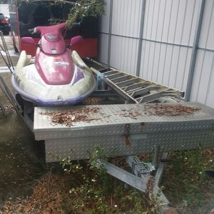 Double Jet Ski trailer with toolbox and free jet ski for Sale in Jacksonville, FL
