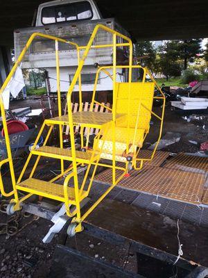 Rolling ladders. 1 orange ladder $500 or best offer. 3 yellow ladders 150 a piece or best offer for Sale in Oakland, CA