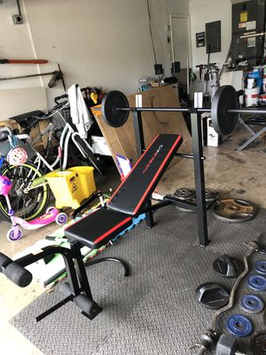 Cap strength weight bench with leg press, barbell and 50lbs of weights for Sale in Tamarac, FL