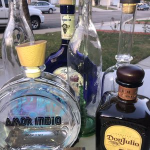 Various Glass Tequila Empty Bottles For Projects Arts Crafts Lighting NOT FREE for Sale in Rancho Cucamonga, CA