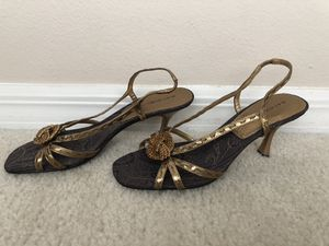 Woman gold tone dress sandals excellent conditions size 7 1/2 for Sale in Deltona, FL