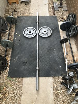 7 foot Olympic Bar / barbell and weight plates...$225 OBO for Sale in Glendale, AZ
