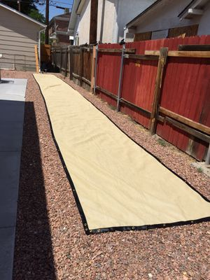 50 ft vinyl fence covering X 5 ft tall With metal grommets brand new never used for Sale in Pueblo, CO