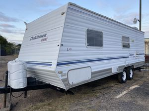 2004 Dutchman light bumper bull 26 feet travel trailer Fully self contained sleeps 6 AC in heat Awning Fridge raider Stove Microwave AM/FM radio for Sale in Dallas, TX