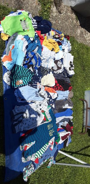 Baby clothes and a stroller with the matching car seat in great condition for Sale in Spokane, WA