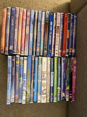 Over 100 DVD's with DVD player for Sale in Delray Beach, FL