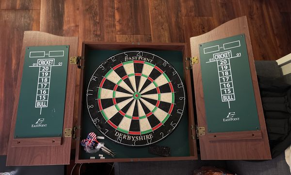 Dartboard In Cabinet And Wooden Poker Carousel