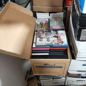 nmixes boxes of DVD's around 60 to 70 singles in them mixed movies selling by box lots 10 each box for Sale in Uxbridge, MA