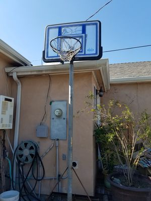 Basketball hoop on heavy iron And wheels for Sale in South El Monte, CA