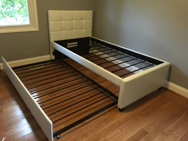 Brand New Twin Size Leather Trundle Bed + 2 Mattresses.