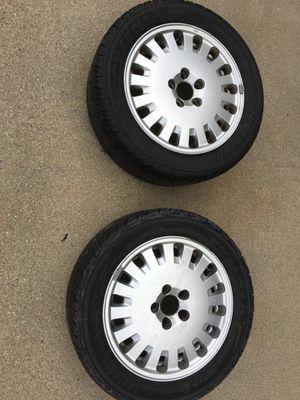 Bridgestone tires and 2 rims for Volvo 2001-2005 for Sale in Lincoln, NE