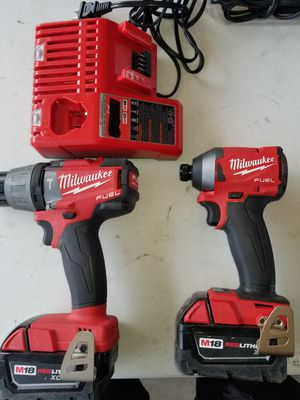 Milwaukee FIRM 2 batteries 5.0 and M18/12 charger for Sale in Houston, TX