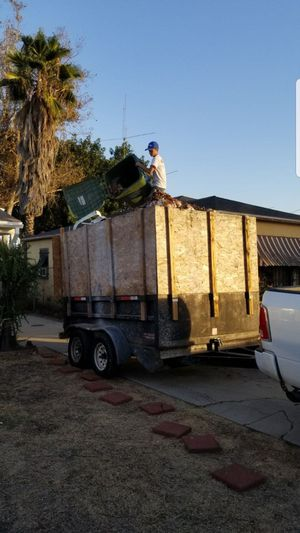 Hydraulic dump trailer works great 8x10x2 plus has 4 ft pieces of plywood added for Sale in Lakewood, CA