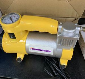 New in box Portable Air Compressor Pump 12V Multi-Use Oil Compressor Tire Pump Inflator Plugs in to cigarette lighter outlet built in flashlight for Sale in San Dimas, CA