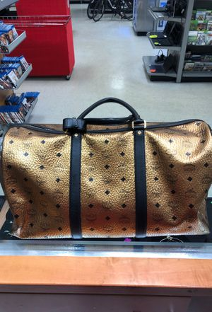 MCM gold and black weekend duffle bag for Sale in Orlando, FL