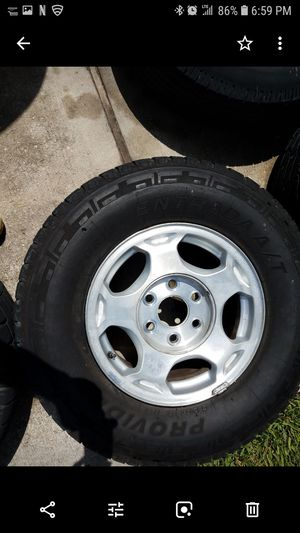 Rims and tires for a 2004 Chevy Suburban for Sale in Humble, TX