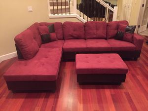 Red microfiber sectional couch and storage ottoman for Sale in Tacoma, WA