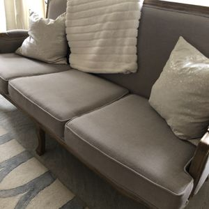 Cool Grey Couch With Wood Trim for Sale in Oregon City, OR