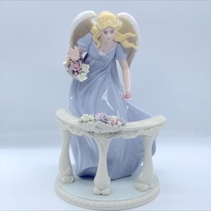 PORCELAIN ANGEL WITH FLOWERS IN VERANDA FIGURINE. for Sale in Las Vegas, NV