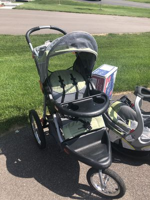 Baby trend jogger with car seat and 3 bases for Sale in Andover, MN
