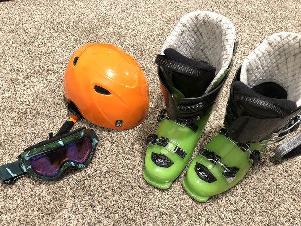 set of skis with boots,poles,helmet,and goggles