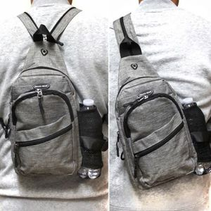NEW! Handy Grey Crossbody/Side Bag/Sling/Pouch Converts to Backpack Style For Everyday Use/Sports/Gym/Hiking/Biking/Outdoors/Fishing for Sale in West Carson, CA