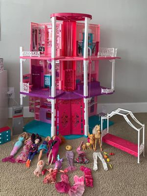 barbie doll house 3 floors with elevator (includes all dolls and dresses) for Sale in Boca Raton, FL