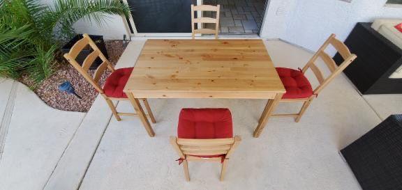 Ikea JOKKMOKK table, Brown with Red Chair cushion.