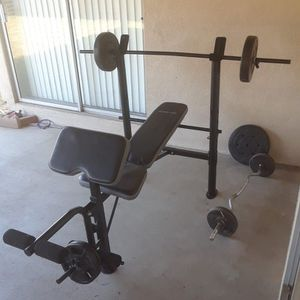 Used good condition weight bench and weights for Sale in Denair, CA