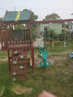 Two swing sets merged together for Sale in Warwick,  RI