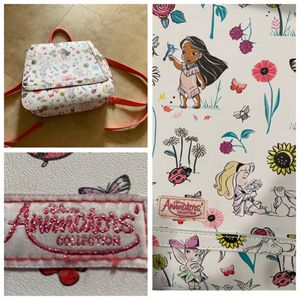 "NEW DISNEY ANIMATORS collection backpack disney store exclusive. Converts to cross body too. 100% New/mint cond! Adjustable or removable straps. 12"" for Sale in Laguna Beach, CA"