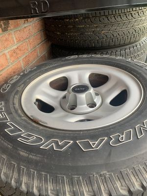 2000 Jeep Wrangler stock rims and tires for Sale in Rockwell, NC