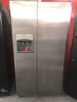 Used Frigidaire 26 cu ft stainless steel side by side fridge. 1 year warranty for Sale in St. Petersburg, FL
