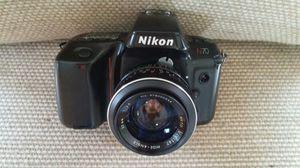 FILM CAMERA NIKON T50 PLUS MANUAL LENS 35MM. for Sale in Miami, FL