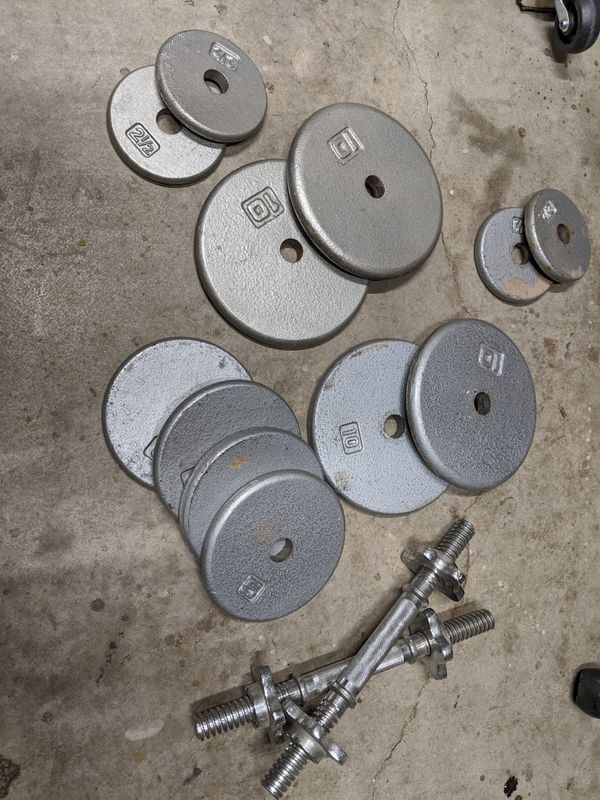 70 pounds of weight plates, with two adjustable dumbbells, (4) 2.5lb, (4) 5 lb, (4) 10lb plates