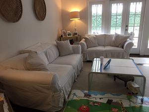 White slip cover sofa and love seat for Sale in Houston, TX