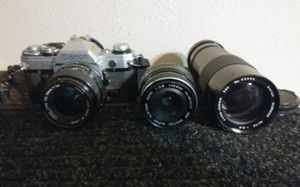 Canon AE-1 film manuel camera w/ extra lenses for Sale in San Bernardino, CA