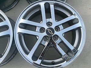 CHEVY CAVALIER CHROME RIMS W/ NEWER TIRES for Sale in Pittsburgh, PA
