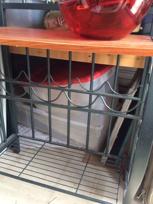 Bakers rack, holds wine too. Shelves above and below wooden shelf for Sale in Lake Wales, FL