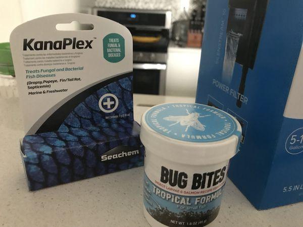 Aquarium essentials- filter, food, net and medication!