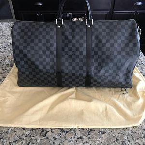 LOUIS VUITTON KEEP ALL BANDOULIERE for Sale in St. Louis, MO