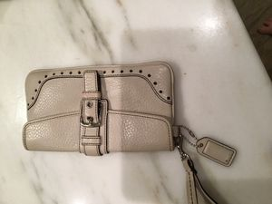 Coach off white polished pebble leather wristlet for Sale in Boston, MA