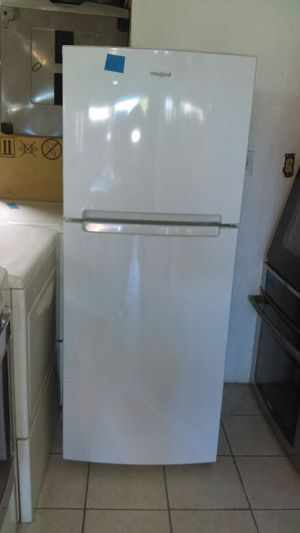 Whirlpool refrigerator White almost new 24wide by 61 1/2 for Sale in Lakewood, CA