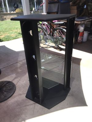 Black Stereo cabinet with glass shelves for Sale in Modesto, CA