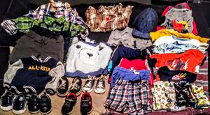 Toddler clothes 12, 18, and 24 months, size 4 and 5 shoes,pajamas and sweaters, baby crib that converts into toddler bed and size 7 diapers for Sale in Bakersfield, CA