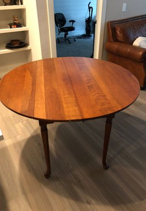 Solid wood dining room table. Great for breakfast room or smaller dining room. Minor wear and tear. Great piece that has two foldable leafs on the for Sale in Nashville, TN